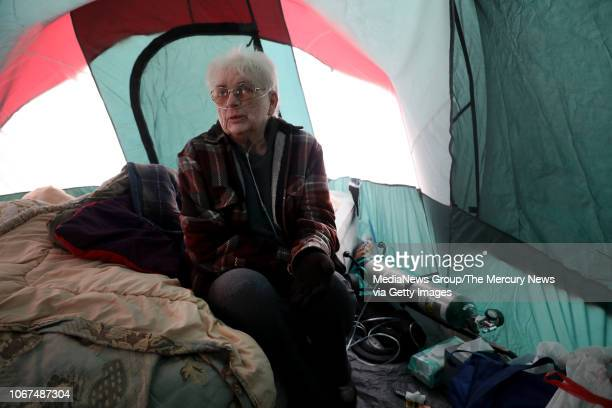 74yearold Jackie Wineland one of the thousands of Camp Fire victims now homeless uses her oxygen tank at tent city growing in the WalMart parking lot...