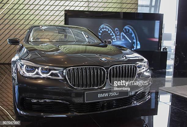A BMW 750Li Xdrive luxury automobile produced by Bayerische Motoren Werke AG sits on display inside the BMW World showroom in Munich Germany on...