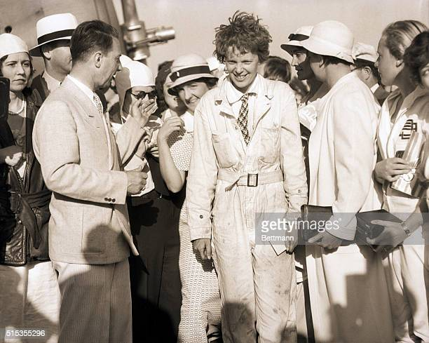 7/5/1933Los Angeles CA Ameilia Earhart greeted by Cliff Henderson Managing Director of the National Air Races upon her arrival at the Los Angeles...
