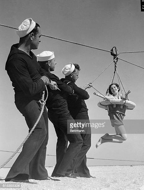 7/5/1933Los Angeles CA Pauline Petrovich is the prize being hauled in by these members of the Coast Guard Base Los Angeles during their demonstration...