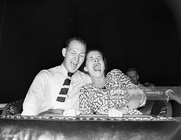 7/5/1946The roller coaster is a rough ride but do they love it This unposed photo was taken by the intrepid photographer from a front seat as the car...