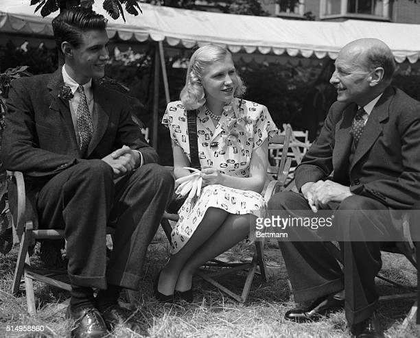 7/5/1947London England Prime Minister Clement Atlee is shown chatting with Miss Sharman Douglas and her brother Peter children of US Ambassador and...