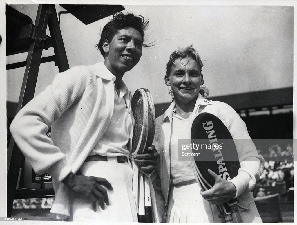 Althea Gibson (l) and Darlene Hard at the Wimbledon Tennis Championships. Waist-up photograph.