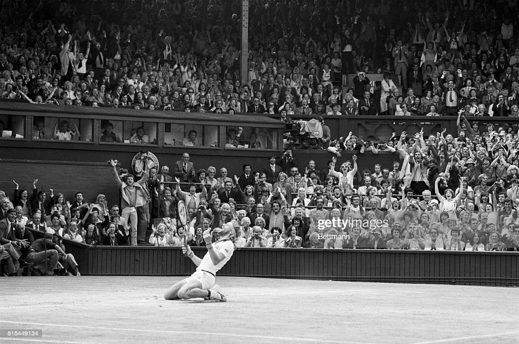 Wimbledon, England- The Men's Single's final- Bjorn Borg (Sweden) sinks to knees after making the winning shot in the final set. He defeated John McEnroe (USA) 7-5, 6-3, 8-6, to win the title for the 5th consectutive time. The crowd background yell their approval.