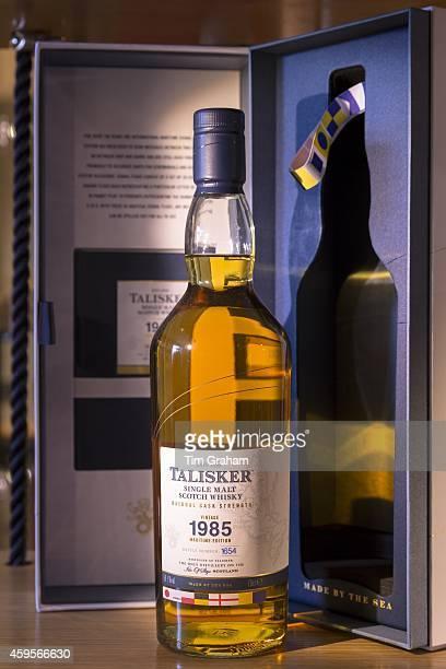 75cl bottle of 1985 vintage Talisker single malt Scotch Whisky and presentation case on display for sale at shop on visitors tour at Distillery in...
