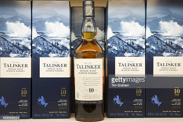 75cl bottles of 10yearold Talisker single malt Scotch Whisky in cartons on display for sale at shop on visitors tour at Distillery in Carbost Isle of...