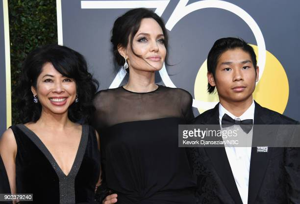 75th ANNUAL GOLDEN GLOBE AWARDS Pictured Activist Loung Ung actor/director Angelina Jolie and Pax Thien JoliePitt arrive to the 75th Annual Golden...