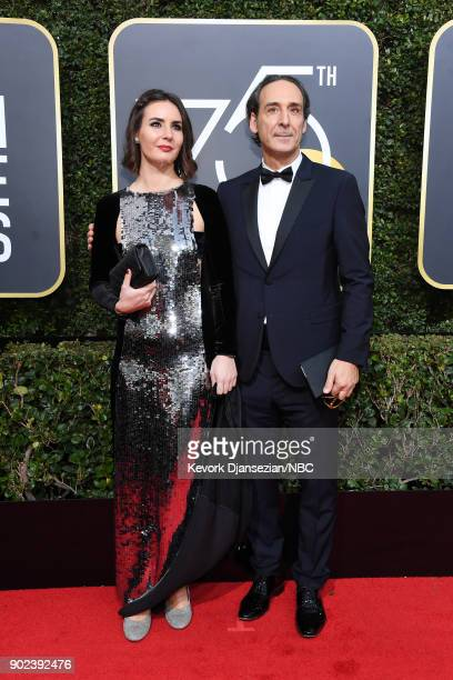 75th ANNUAL GOLDEN GLOBE AWARDS Pictured Actor Antonia Desplat and composer Alexandre Desplat arrive to the 75th Annual Golden Globe Awards held at...