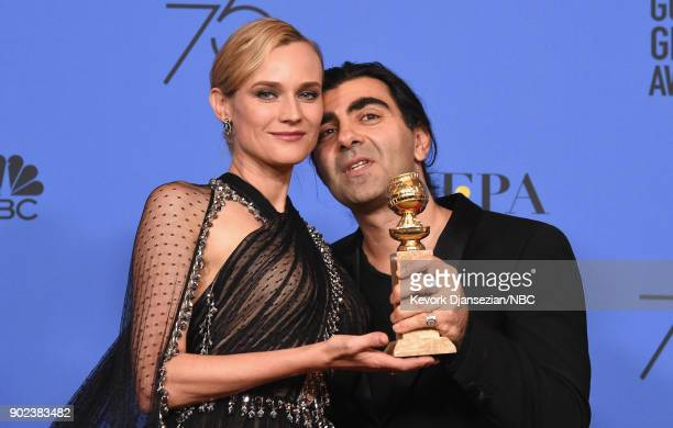 75th ANNUAL GOLDEN GLOBE AWARDS Pictured Actor Diane Kruger and director Fatih Akin pose with the Best Motion Picture Foreign Language award for 'In...