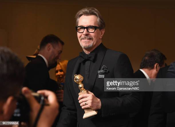 75th ANNUAL GOLDEN GLOBE AWARDS Pictured Actor Gary Oldman poses with the Best Performance by an Actor in a Motion Picture Drama award for 'Darkest...