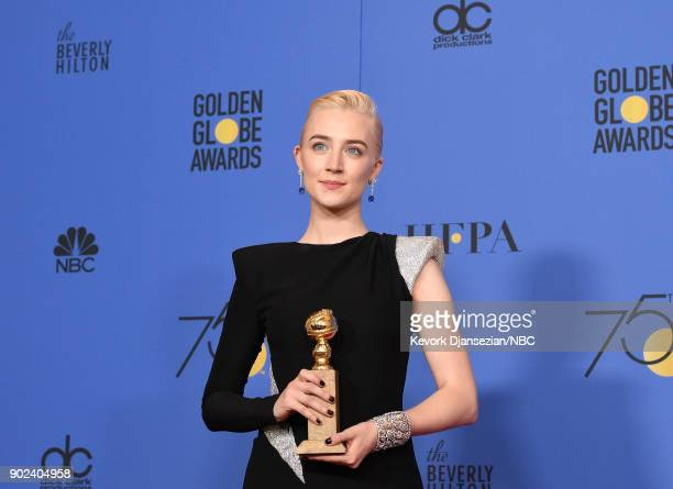 75th ANNUAL GOLDEN GLOBE AWARDS Pictured Actor Saoirse Ronan poses with the Best Performance by an Actress in a Motion Picture Musical or Comedy...