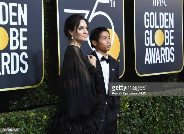 75th ANNUAL GOLDEN GLOBE AWARDS Pictured Actor/director Angelina Jolie and Pax Thien JoliePitt arrive to the 75th Annual Golden Globe Awards held at...