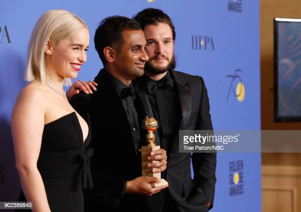 75th ANNUAL GOLDEN GLOBE AWARDS Pictured Actors Emilia Clarke and Kit Harington pose with Aziz Ansari and his award for Best Performance by an Actor...