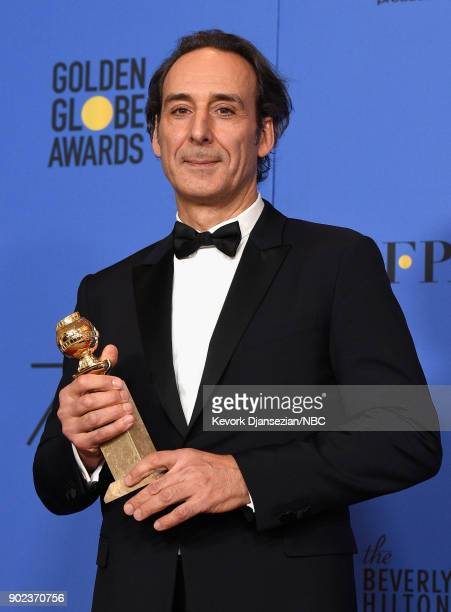 75th ANNUAL GOLDEN GLOBE AWARDS Pictured Composer Alexandre Desplat poses with the Best Original Score Motion Picture award for 'The Shape of Water'...