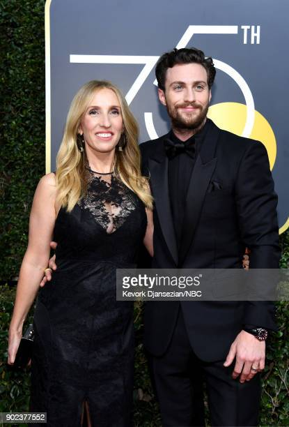 75th ANNUAL GOLDEN GLOBE AWARDS Pictured Filmmaker Sam TaylorJohnson and actor Aaron TaylorJohnson arrive to the 75th Annual Golden Globe Awards held...