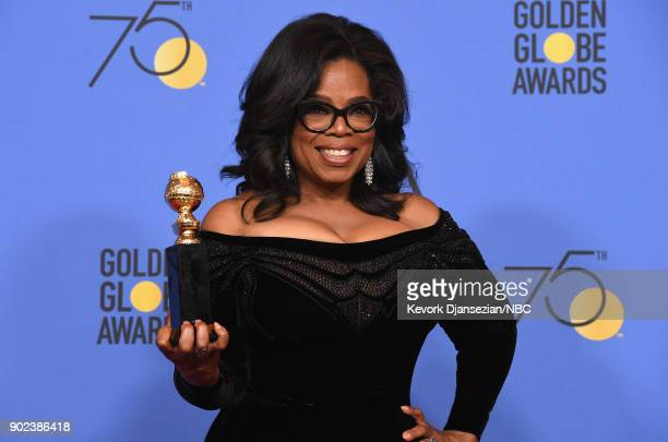75th ANNUAL GOLDEN GLOBE AWARDS Pictured Oprah Winfrey recipient of the Cecil B DeMille Award poses in the press room at the 75th Annual Golden Globe...