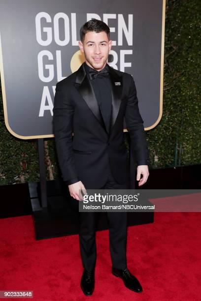 75th ANNUAL GOLDEN GLOBE AWARDS Pictured Recording artist Nick Jonas arrives to the 75th Annual Golden Globe Awards held at the Beverly Hilton Hotel...