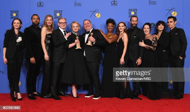 75th ANNUAL GOLDEN GLOBE AWARDS Pictured The cast and crew of 'The Handmaid's Tale' poses with Best Television Series Drama award in the press room...