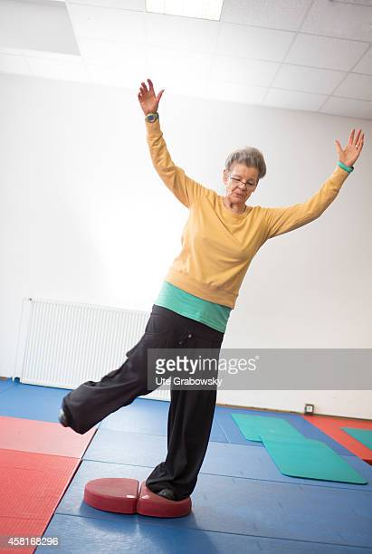 75yearold woman doing balance training in a gym on October 09 in Bonn Germany The WHO recommends older adults to stay physically active in order to...