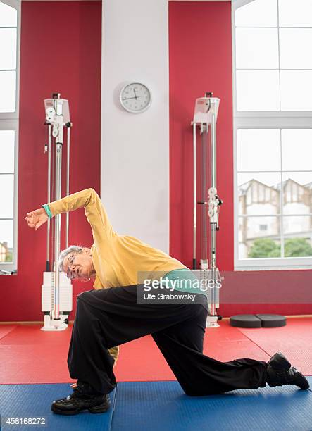 75yearold woman exercising in a gym on October 09 in Bonn Germany The WHO recommends older adults to stay physically active in order to increase and...