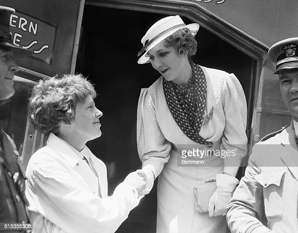 7/6/1933Los Angeles CA Photo shows a closeup of Mary Pickford and Amelia Earhart shaking hands They are shown at the National Air Races