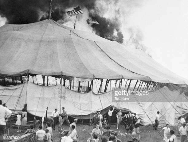 """Hartford, CT- As flames consumed the huge """"big top"""", smoke can be seen at top of photo of the Ringling Brothers and Barnum and Bailey Circus this..."""