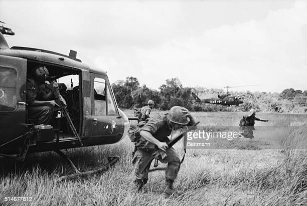 War Zone D, South Vietnam: United States paratroopers of the 173rd Airborne disembark from their helicopters as they join with Vietnamese and...