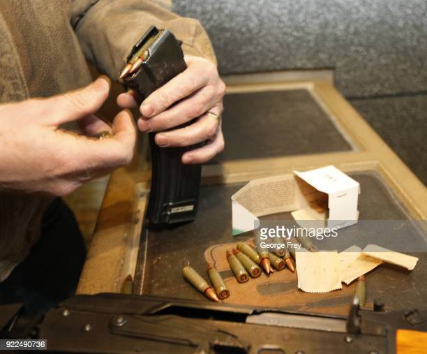 762X39mm round are loaded into 30 round magazine for an AK47 at Good Guys Gun and Range on February 21 2018 in Orem Utah The bump stock is a device...
