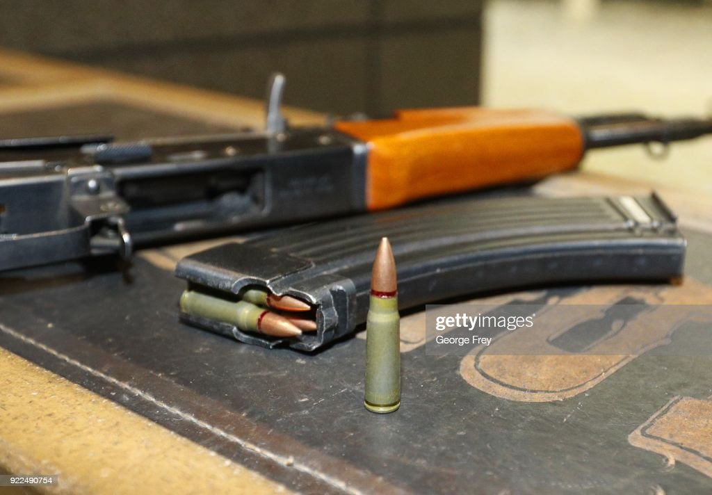 A 7,62X39mm round sits next a a 30 round magazine and an AK-47 at Good Guys Gun and Range on February 21, 2018 in Orem, Utah. The bump stock is a device when installed allows a semi-automatic to fire at a rapid rate much like a fully automatic gun.