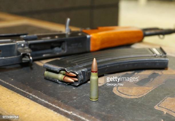 A 762X39mm round sits next a a 30 round magazine and an AK47 at Good Guys Gun and Range on February 21 2018 in Orem Utah The bump stock is a device...