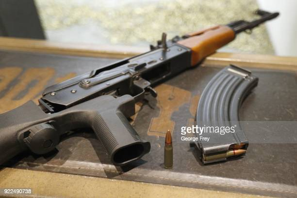 A 762X39mm round sits next a a 30 round magazine and an AK47 with a bump stock installed at Good Guys Gun and Range on February 21 2018 in Orem Utah...