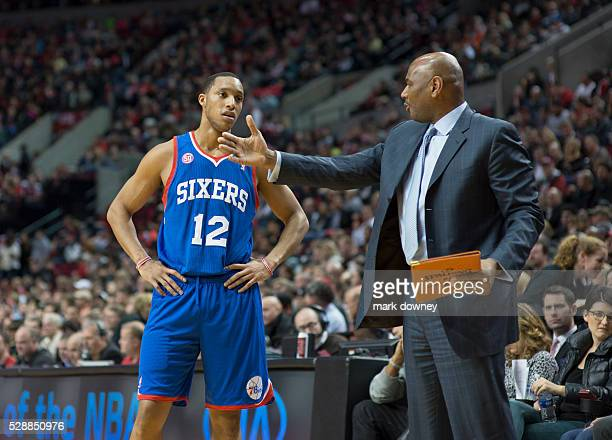 76ers Evan Turner listens to a lecture from Michael Curry after a call