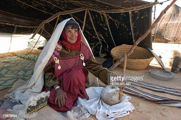 A 76old nomad Tunisian woman Mabrouka prepares semolina 27 December 2006 in the town of Douz as the 39th International Sahara Festival closes The...