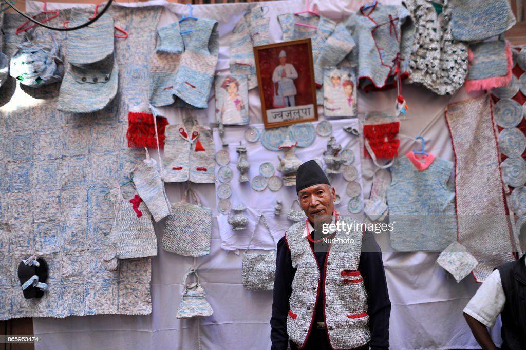 76yrs old, BABU KAJI MAHARJAN along with his skills by weaving wearable products from waste plastic materails during inauguration ceremony of Jyapu Museum on the occasion of 72nd United Nations Day in Chyasal, Lalitpur, Nepal on Tuesday, October 24, 2017.