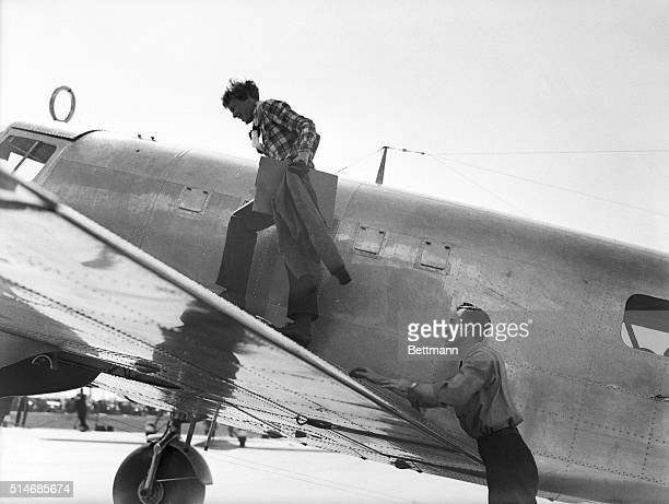 7/7/1937Los Angeles CA Here is the last picture made in Los Angeles of Amelia Earhart missing with her navigator as she completed preparations for...