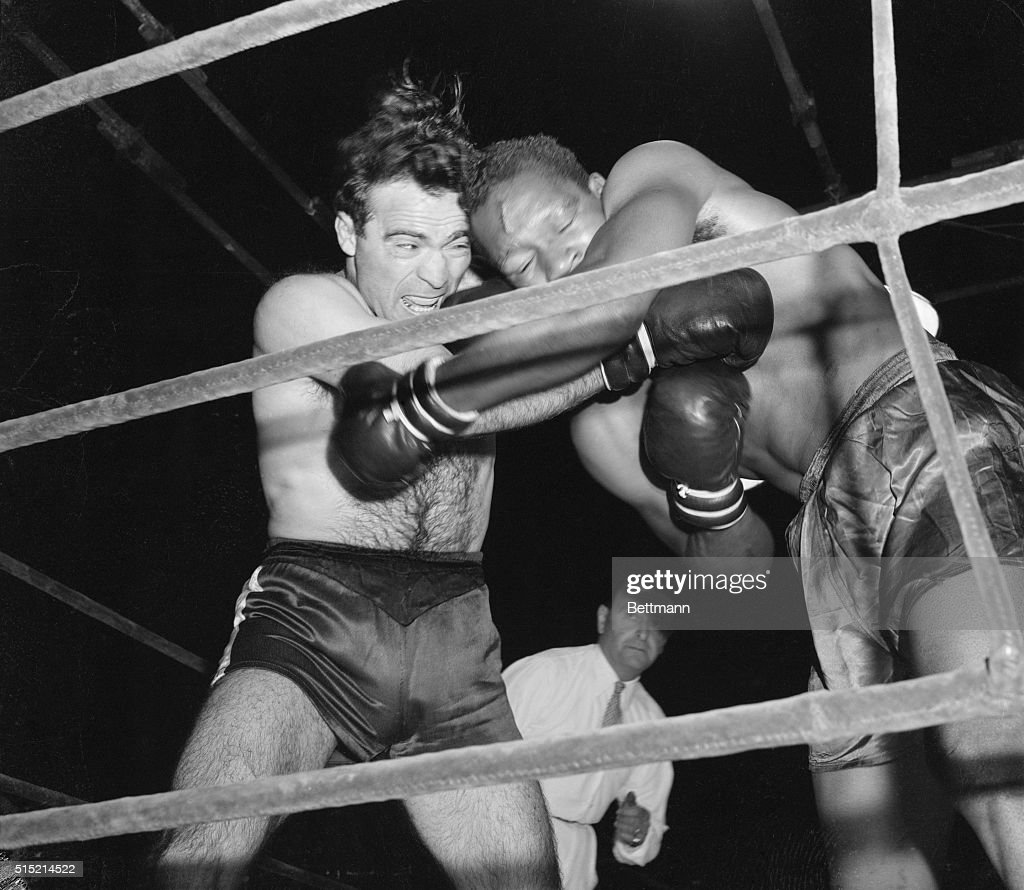Marcel Cerdan (L) connects in close-in fighting in the fourth round of ten against Holman Williams of Chicago. The French middleweight champ won on points.