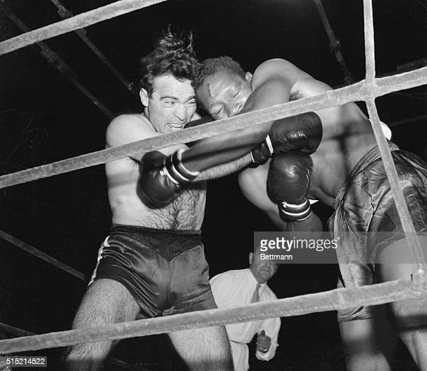 Paris, France-: Marcel Cerdan connects in close-in fighting in the fourth round of ten against Holman Williams of Chicago. The French middleweight...