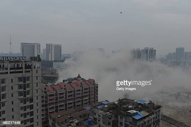 Meter Yinfeng hotel is demolished by blasting on December 9, 2014 in Wuhan, Zhejiang province of China. Three buildings were demolished by blasting...