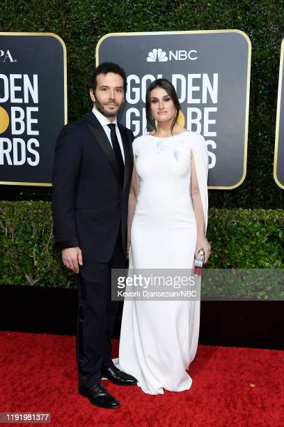 77th ANNUAL GOLDEN GLOBE AWARDS -- Pictured: Aaron Lohr and Idina Menzel arrive to the 77th Annual Golden Globe Awards held at the Beverly Hilton...