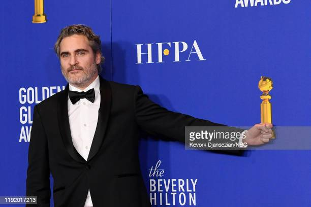 77th ANNUAL GOLDEN GLOBE AWARDS Pictured Joaquin Phoenix poses in the press room after winning the award for Best Performance by an Actor in a Motion...