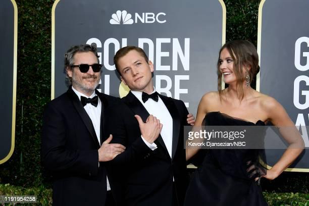 77th ANNUAL GOLDEN GLOBE AWARDS Pictured Joaquin Phoenix Taron Egerton and Emily Thomas arrive to the 77th Annual Golden Globe Awards held at the...