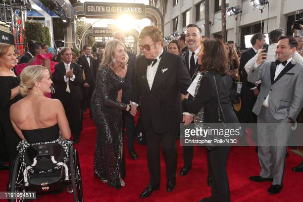 77th ANNUAL GOLDEN GLOBE AWARDS Pictured Nadia Comneci and Elton John arrive to the 77th Annual Golden Globe Awards held at the Beverly Hilton Hotel...