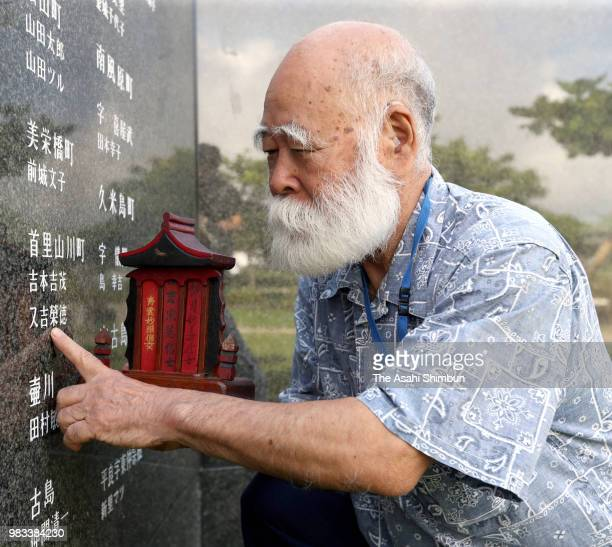 77yearold Eiichi Matayoshi prays for his younger brother at the Cornerstone of Peace where the names of their bereaved family members and relatives...