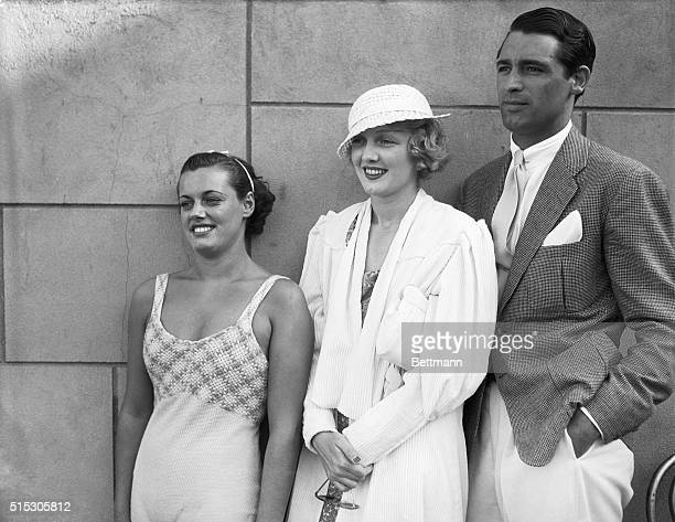 Los Angeles, CA- Eleanor Holm, Virginia Cherrill, and Cary Grant at the swimming pool of the Ambassador Hotel in Los Angeles.