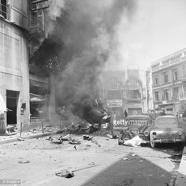 7/8/1958Beirut Lebanon Smoke rises from the shattered wreckage of the large ABC department store Scores of people were reported injured when a...