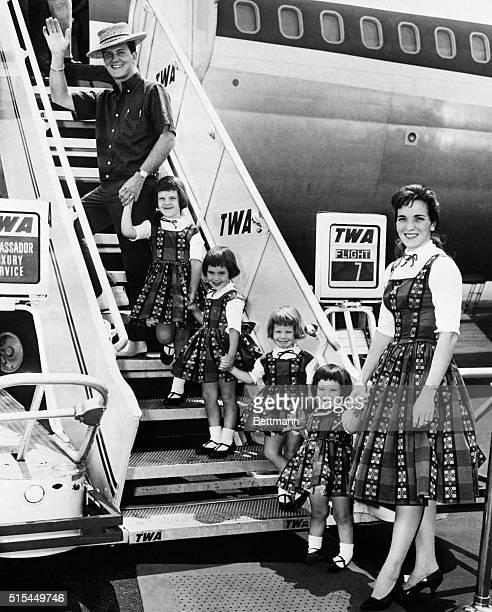 7/8/1960New York NY With his family in tow singer Pat Boone bids goodbye to New York as he boards a Trans World Airlines jet at Idlewild Airport...