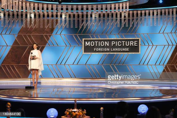 78th Annual GOLDEN GLOBE AWARDS -- Pictured: Gal Gadot speaks onstage at the 78th Annual Golden Globe Awards held at The Beverly Hilton and broadcast...