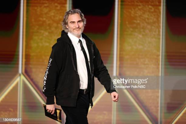 78th Annual GOLDEN GLOBE AWARDS -- Pictured: Joaquin Phoenix walks onstage at the 78th Annual Golden Globe Awards held at The Beverly Hilton and...