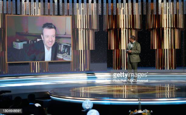 78th Annual GOLDEN GLOBE AWARDS -- Pictured: Peter Morgan accepts the Best Drama Series award for 'The Crown' via video from Kenan Thompson onstage...
