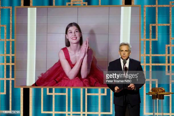 78th Annual GOLDEN GLOBE AWARDS -- Pictured: Rosamund Pike accepts the Best Actress - Motion Picture – Musical/Comedy award for 'I Care a Lot' via...